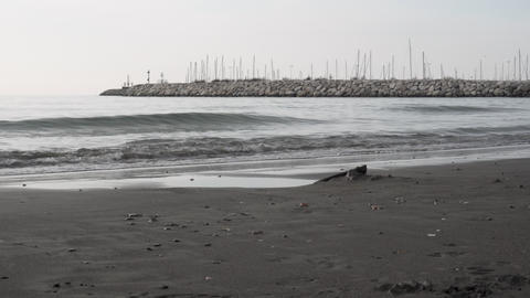 Waves on the gray winter beach in Salerno in Italy - Medium Shot Live Action