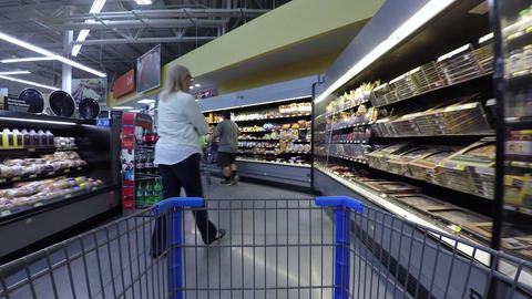 Wife shopping grocery store cart POV 4K 850 Footage