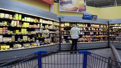 Woman shopping dairy milk cheese department POV 863 Footage