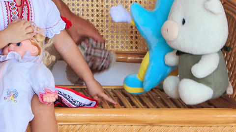 Little Girl in Vyshyvanka Plays with Toys on Armchair Footage