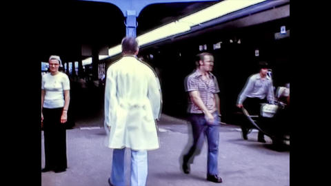 LOURDES, FRANCE 1974: People traveling in the Lourdes train station in the mid 70s Live Action