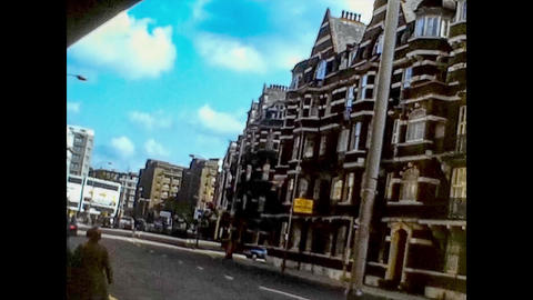 LONDON, UK 9 JUNE 1975: Streets of London in daily life taken up in the mid 70's, 4K Digitized Live Action