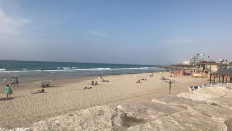 Tel Aviv, Israel - October 22, 2019: tourists relax on the beach Live Action