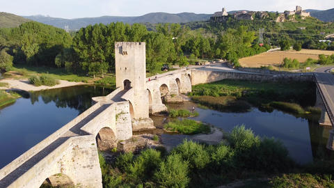 Aerial view of a medieval stone bridge over Ebro river in Frias, historic Live Action