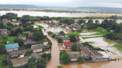 People who are in a flooded house by a river that overflowed after rain floods Live Action