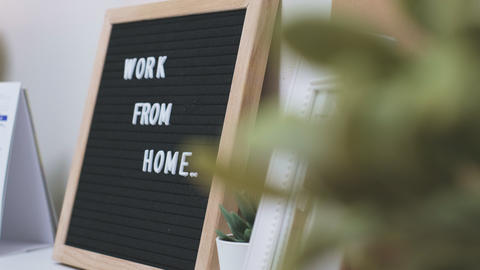 """Felt letter board """"work from home"""" on brown wood background with alcohol gel ,for corona virus Live Action"""