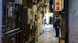 Japanese salary-man smoking in an alley near Yurakucho, Tokyo Footage