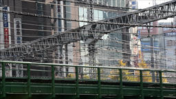 Railway with wiring and buildings in the background, Shinjuku, Tokyo Footage