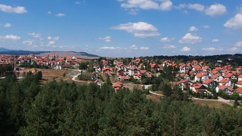 Mountain village skyline. Aerial view of pine forest at Zlatbor mountain, Serbia Live Action