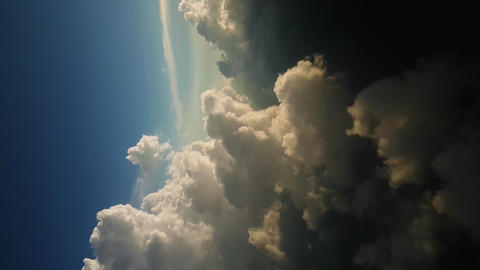 Vertical Video, Sunlight Above Stormy Clouds and Clear Blue Sky Live Action
