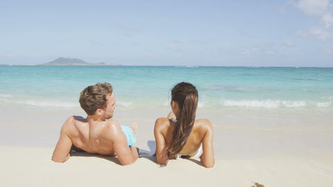 Beach relaxing on holiday vacations in holidays suntan concept Live Action