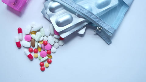 high angle view of colorful pills on white background Live Action