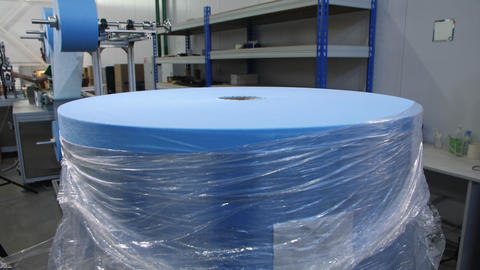 blue textile roll for disposable protective masks production Live Action