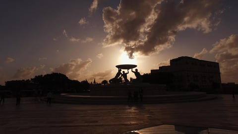 Valletta, Malta. Silhouette of Tritons Fountain in the Evening Under Summer Sky Live Action