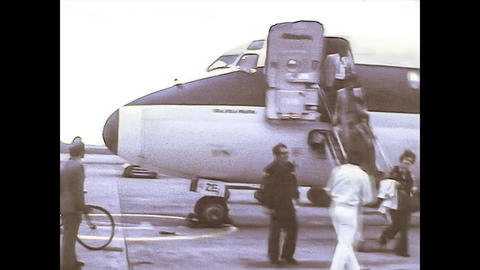 MILAN 1976: People get off the plane in Milan Airport Live Action
