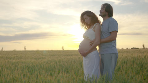Pregnant couple of husband and wife feels love and relax at home. Young Live Action