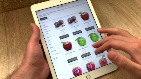Close up selection of juicy beautiful fruits and berries in an online store Live Action