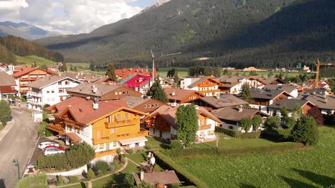 Aerial view of Dobbiaco in summer season, Italian Alps Live Action