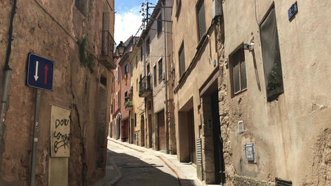 Montblanc, Spain, A narrow city street with buildings on the side of a building Live Action