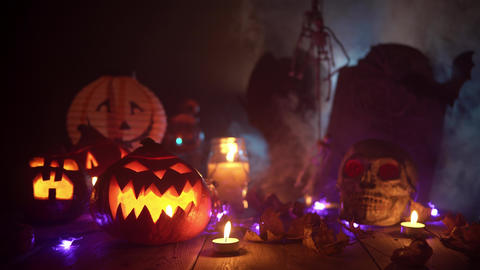 Scary decorations for the magic holiday Halloween in a thick fog Live Action