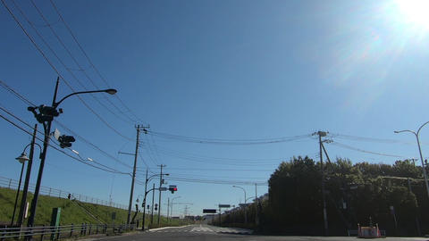 Intersection with traffic lights on a sunny day GIF