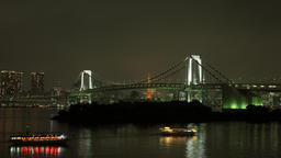 Time lapse night view of Rainbow Bridge and Tokyo Tower with cityscape in the ba Footage
