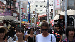 People walking at Takeshita Dori street in Harajuku, Tokyo, Japan Footage