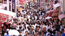 People walking at Takeshita Dori street in Harajuku, Tokyo, Japan Footage