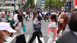 People walking at Shibuya scramble crossing, Tokyo, Japan Footage