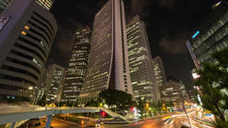 Time-lapse pan down view of Sompo Japan Head Office Building and traffic in Shin Footage
