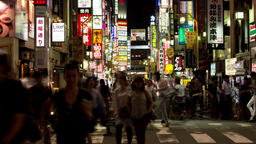 Time-lapse night view of people walking around Kabukicho area in Shinjuku, Tokyo Footage