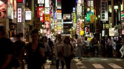 Time-lapse night view of people walking around Kabukicho area in Shinjuku, Tokyo Footage