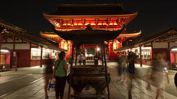 Time-lapse zoom-out front view of people walking by incense cauldron at Senso-ji Footage