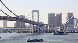 Boats cruising at Tokyo Bay and Tokyo cityscape with Rainbow Bridge in the backg Footage