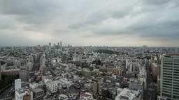 Time Lapse Pan Up View Of Tokyo Cityscape and Clouded Sky, Tokyo, Japan Footage