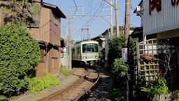 Enoden train approaching in Enoshima, Kanagawa Prefecture, Japan Footage