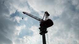 Time lapse view of clouds moving behind construction crane silhouette, Tokyo, Ja Footage