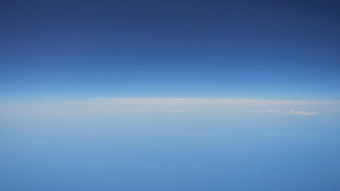 At sea, Japan-June 23, 2020: View of horizon from the window in the airplane Live Action