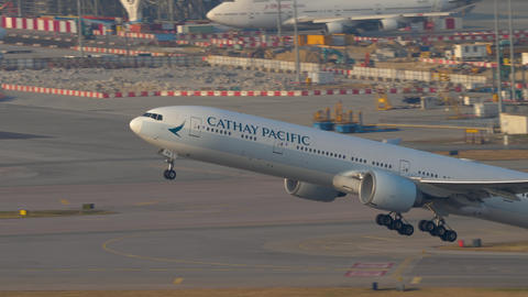 Cathay Pacific Boeing 777 departure from Hong Kong Live Action