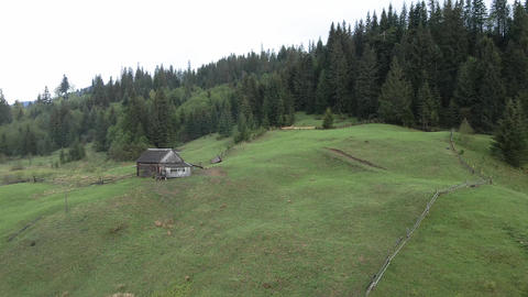 Ukraine, Carpathian Mountains: House in the mountains Aerial Live Action