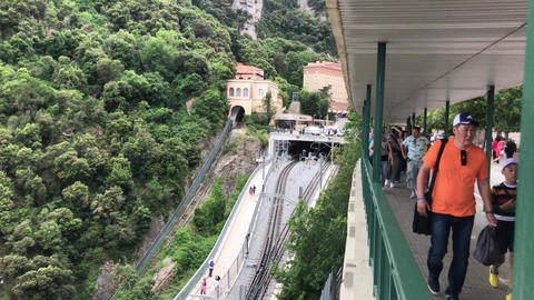 Montserrat, Spain, June 26 2019: A group of people traveling on a train track Live Action