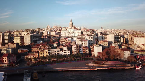 Galata Tower on Golden Hour Sunlight. Aerial of Istanbul, Turkey From Bosphorus Live Action