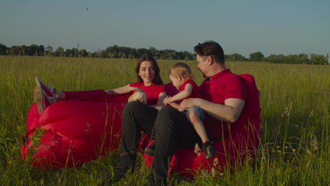 Relaxed family with baby enjoying summer nature Live Action