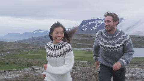 People having fun running playful in Iceland nature Live Action