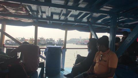 Mumbai, India - November 10, 2019: Arabian Sea tourists sit on a pleasure boat Live Action