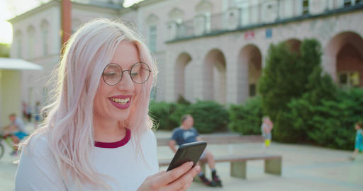 Beatiful Lady Using a Phone Outdoors Live Action