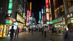 Time lapse zoom-in footage of people walking in Shibuya district at night, Tokyo Footage
