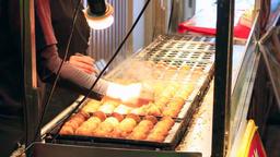 Osaka, JP - January 24, 2015: Takoyaki (Octopus balls) being prepared at Dontonb Footage