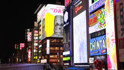 Osaka, JP - January 24, 2015: The Glico Running Man and other neon signs at the  Footage