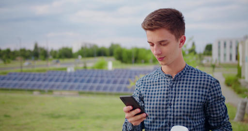 Young Man Using a Phone Outdoors Live Action